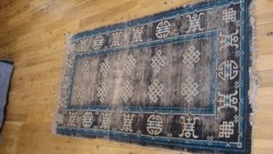 antique rug before water damaged