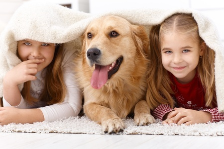 kids with dog on a shag rug